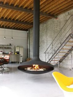 Collection of modern fireplace designs with contemporary styles. Will greatly spoil your eyes with a modern and contemporary look. Modern Stone Fireplace, Modern Fireplace Mantels, Minimalist Fireplace, Stone Fireplace Designs, Fireplace Tile Surround, Rustic Fireplaces, Fireplace Surrounds, Suspended Fireplace, Floating Fireplace