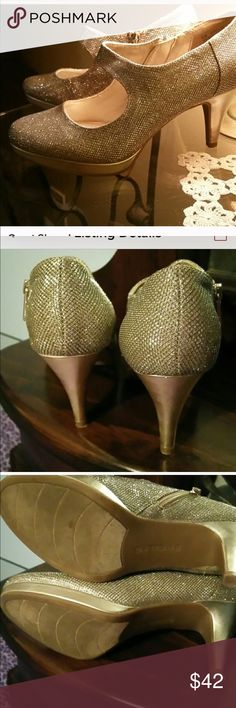 Gold shoes super cute gently used Gold heels zipper on the side gently used Bandolino Shoes Ankle Boots & Booties