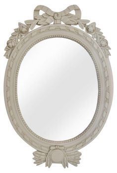 A sweet Gustavian style oval mirror, made in Sweden and imported by Country Swedish. Carved wood and painted grey. This piece is the perfect feminine touch for an entry way or above a fire place.