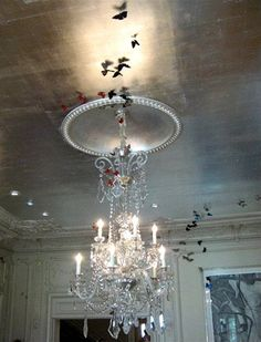 Who knew a metallic ceiling could look so amazing? I love the whimsy that the butterflies add. This ceiling has been done with silver leaf, but a similar look could be achieved with metallic paint (available at most big box home improvement stores). This look would be great in a bathroom, a dining room, or even in a bedroom.