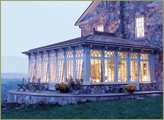 I want to move in here...look at that view! just beautiful windows on that stone house...gorgeous.I want too :)