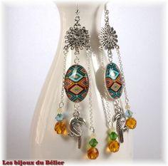 Boucles d'oreilles pendantes tropicales ethniques avec toupies Swarovski et pélican : Boucles d'oreille par les-bijoux-du-belier