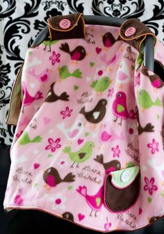 I love how this pattern wraps around the outside to keep it from hanging on the baby. Looks perfect for cold weather. Plus there's a video tutorial to walk you through how to make it! Great sewing DIY idea. via @FleeceFun Perfect sewing project.