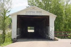 Mansfield Covered Bridge over Big Raccoon Creek, Mansfield, Indiana next to the still operating mill & mill dam.