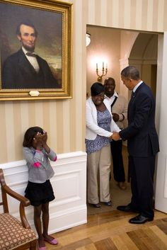 Eight-year old Make-A-Wish child Janiya Penny reacts after meeting President Barack Obama as he welcomes her family to the Oval Office, Aug. 8, 2012.