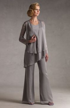 Grey mother of the groom pant suits are a comfortable outfit to wear at #weddings for any mother. This long sleeve ensemble has a tiered jacket and wide leg chiffon pants. Let our USA dress company recreate this look for you for less in any size or color.  See other #fashion designs for women and mother of the groom formal wear pants at www.dariuscordell.com