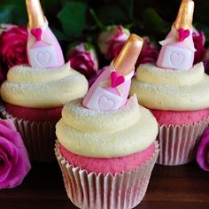 Recipe & tutorial for indulgent pink champagne cupcakes with mini fondant pink champagne bottles nestled on top