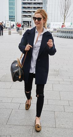 Cute and casual: Lily James was wearing ripped jeans and leopard print pumps as she arrive...