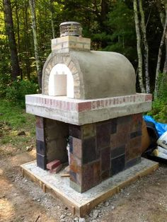 The Nitchman Wood Fired Brick Pizza Oven in Maine.  This oven was built with the Mattone Barile Grande pizza oven form by BrickWood Ovens.