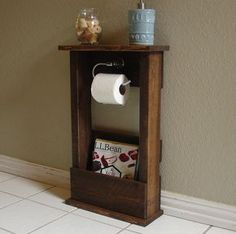 Toilet Paper Holder Stand with Top Shelf and Storage Pocket for Magazines by KeoDecor on Etsy https://www.etsy.com/listing/254910409/toilet-paper-holder-stand-with-top-shelf