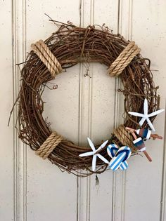Beach Wreath, Summer Beach Wreath, Coastal Wreath, Beach House Wreath, Starfish Wreath, Front Door Wreath, Beach House Decor, Coastal Decor An 18 grapevine wreath decorated with rope, starfish, flip flops, and a buoy. Perfect for decorating your beach house! All wreaths are treated
