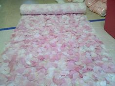 DIY Aisle Runner: silk petals affixed to runner using spray adhesive. For touch-ups use hot glue & petals.