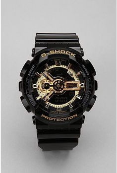 G-Shock Black And Gold Watch. PRS is a licensed carrier of G-Shock watches! Stylish Watches, Cool Watches, Watches For Men, Sport Watches, G Shock Watches, Casio G Shock, Oakley, G Shock Black, Beautiful Watches