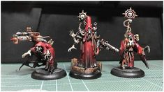 Dark Mechanicus Trio.  Kitbashed custom 28mm scale models. Using various parts from a variety of kits, epoxy clay and good old guitar wire. Painted with acrylics and inks.  Intended for I...