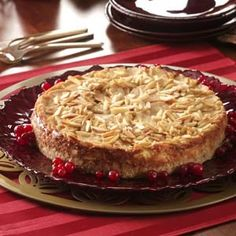 Almond Pear Torte - Yum! This recipe combines cheesecake, pears and nutmeg for a scrumptious holiday dessert. I sprinkle slivered almonds on top. —Trisha Kruse, Eagle, Idaho