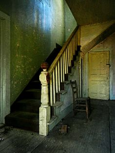 The empty stairhall with an old ladder-back chair and single-bulb floor lamp. Abandoned Buildings, Abandoned Asylums, Old Abandoned Houses, Abandoned Places, Real Haunted Houses, Haunted Places, Victorian Farmhouse, Victorian Homes, Scary Ghost Pictures