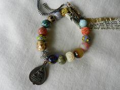 Buddha Bracelet (Inlaid Turquoise Bead from Nepal, Vintage Carved Bone Rose, Sponge Coral, Tibetan Wooden Buddha Bead, Powdered African Krobo Glass, Vintage Thai Buddha Amulet, Venetian Trading Bead, Crystal, Cast Brass from Ghana)