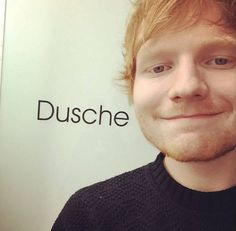 Instagram picture of Ed Sheeran posing in front of the word 'Dusche' #redheads