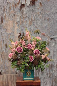Dahlia 'Frost Nip', cerinthe, daucus, monarda, eryngium, snapdragon, ninebark, baptisia foliage and pods, mountain mint, air plants