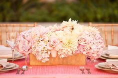 Centerpiece in blush pink and ivory in gold rectangular container.    25 WEDDING CENTERPIECES - Belle the Magazine . The Wedding Blog For The Sophisticated Bride