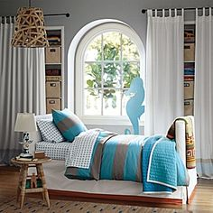 Turquoise bedding with neutral accent
