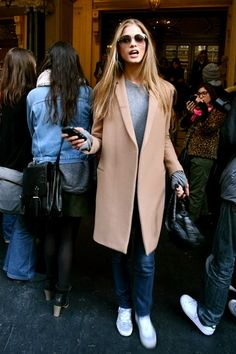 Just can't stop wearing classic camel coat with sneakers