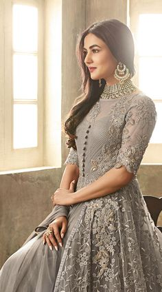 This #Grey High Netted #Anarkali #Suit has Thread Sequins and #Stone Work #Embroidery. It has #Net #Top and #Santoon #Bottom with #Nazneen #Dupatta worn by #Sonal #Chauhan.  #Anarkalisalwarkameez, #Anarkalisuit, #Bollywoodactressesanarkalisuits #Bollywooddress #designersuits #USA #UK #Brazil #indianfashion #indianwear #indiandress #Indianwedding #Stylishdress #beautifuldress