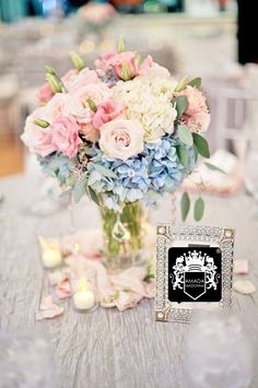 light pink and blue centerpieces (also love the silhouette faces on the table numbers) Blue And Purple Flowers, Blue Wedding Flowers, Bridesmaid Flowers, Floral Wedding, Wedding Colors, Wedding Bouquets, Trendy Wedding, Pink Roses, Pink Purple