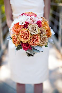Pink and orange wedding bouquet. I think the colors in this and the roses are my absolute favorite yet.