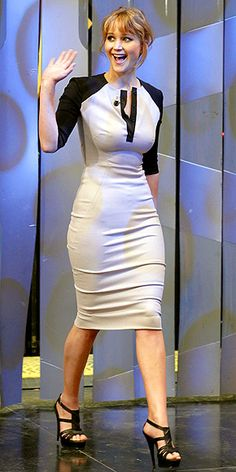 JENNIFER LAWRENCE  Trading in her Hunger Games garb for something a little more stylish, the actress visits a Madrid TV show in a fitted two-tone sheath and sexy stilettos.