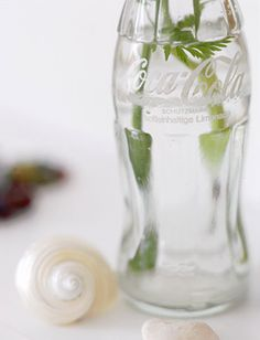 I love this idea: flowers in a glass coke bottle.