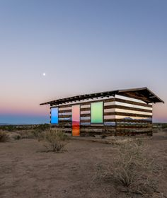 lucid stead in the desert. a gorgeous wood and mirror panel desert house.