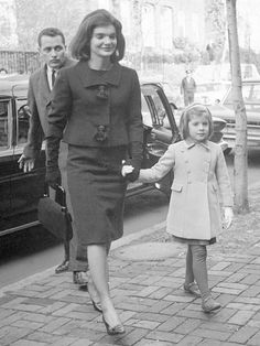 December 6, 1963 -- Jacqueline Kennedy and six-year-old Caroline. Secret Service agent Clint Hill is behind Jackie