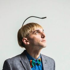 Neil Harbisson is an officially-recognized cyborg who suffers from achromatopsia (can only see in greyscale), and has developed an antennae that lets him interpret colours into his brain via vibrations and sound.