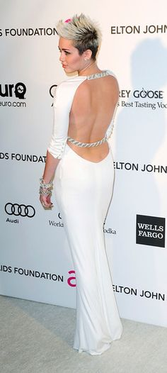 Performer Miley Cyrus arrives at the 2013 Elton John AIDS Foundation Oscar Party in West Hollywood, California, February 24, 2013. REUTERS/Gus Ruelas