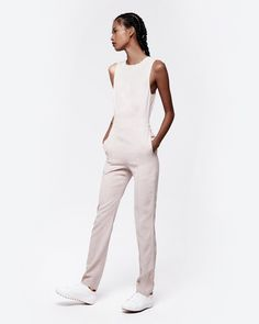Sleeveless. Nude satin. Empire waist. Side slit pockets. Functional ankle zippers. Super snug fit. Order one size up for more comfortable wear.