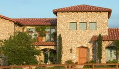 Tuscan stone home designed and built in Austin