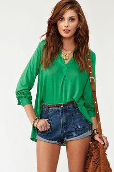 Insanely soft green shirt featuring a split neckline and pleated detailing. Button closures at cuff, cut longer at back. #nastygal