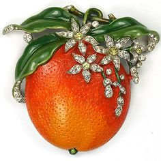Trifari 'Alfred Philippe' Orange Fruit Pin Clip / rhodium plated base metal, rhinestones, enameling / Marked: Trifari with Crown, Pat Pend / Reference: Patent is reproduced below (scroll down); designer A Philippe, dated 1941 / 3850