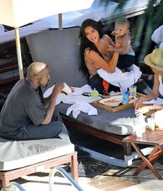 Kim Kardashian plants kisses on Saint during pool day with North and Kanye West Daily Mail Online Kim Kardashian And Kanye, Kardashian Family, Kardashian Style, Kardashian Jenner, Kanye West And Kim, Kyle Jenner, Jenner Family, Cute Celebrities, Family Goals