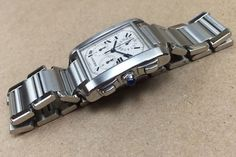 Cartier   *   Tank Francaise Chronograph   *   Near Perfect   *   Box  *   Serviced   *   One Year Warranty   Brand/Manufacturer:     	Cartier Model:        					Chronograph Ref./Serial/Year:      		2000 's Case:        					S.Steel  31 x 36 mm Bezel:        					 N/A Band:            				 Near perfect  16 links Dial:         					100% Original. Perfect Movement:       				Serviced and running perfect in every way. #HallandLaddCo #forsale