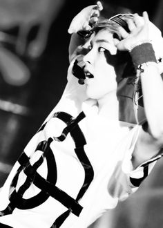 Xiumin looking bold and striking in black and white.