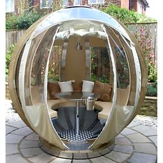 Not sure how I feel about this Rotating Sphere Lounger... for a super-modern urban patio perhaps
