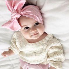 Pink headband and sweater she looks so huggable