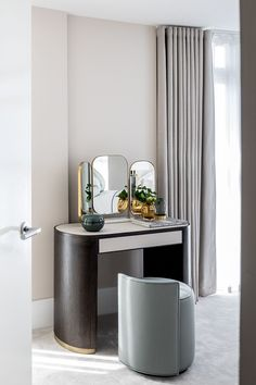 A simple yet elegant corner where you can get ready and plan your day ahead. The team designed a compact and soft shaped dressing table, with beautiful leather inserts, to bring warmth and act as a contrast between the timber and brushed brass detailing. A perfectly light sage pouf with back detailing, soft-to-the-touch carpet, and light under-toned taupe curtains added to the final luxe feel. Luxury Interior, Interior Architecture, Interior Design, Furniture Dressing Table, Pent House, Interior Inspiration, Bedroom Inspiration, Design Consultant, Brass