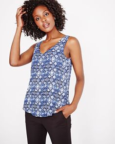 This printed woven cami blouse is a must-have to add to your top collection this season! Wear yours alone or as a layering piece under a blazer or cardigan. <br /><br />- Double layer<br />- Wide strap