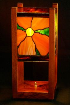 A small night stand lamp with a unique flower design on each side. The base is crafted of African Mahogany.