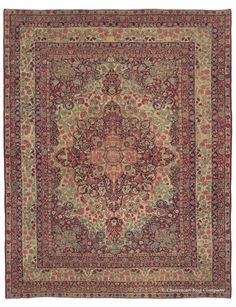 Laver Kirman, 8ft 11in x 11ft 7in, Late 19th Century. This extraordinarily beautiful room size antique Oriental carpet in the Laver Kirman rug style is a superlative example of the heights of weaving achieved even at the end of the Second Golden Age of Persian weaving. Its splendiferous floral display is harmoniously ordered. Every hue of its wide magical palette is in balance with the entirety while each very clearly drawn botanical flourish is in exquisite proportion to the whole.