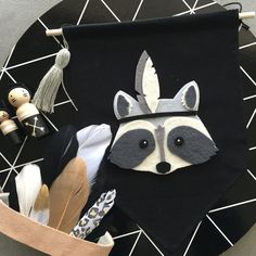 Dash the raccoon wall banner - made to order This banner is made black fabric that has been glued on all sides using long lasting fabric glue. Dash the raccoon is made of felt and is hand cut and fabric glued to the banner. Banners come with a wooden rod and twine A tassel can be added if desired The banners measure approx 23cm (rod length) x 28cm (longest length) Custom orders welcome. All banners can be completely personalised to your choice of letters or colours along with tassels/po...