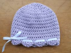 Light purple beanie featuring white bow by Littlest Yarn Shop To purchase: https://www.etsy.com/listing/127006842/0-to-3-months-light-purple-beanie